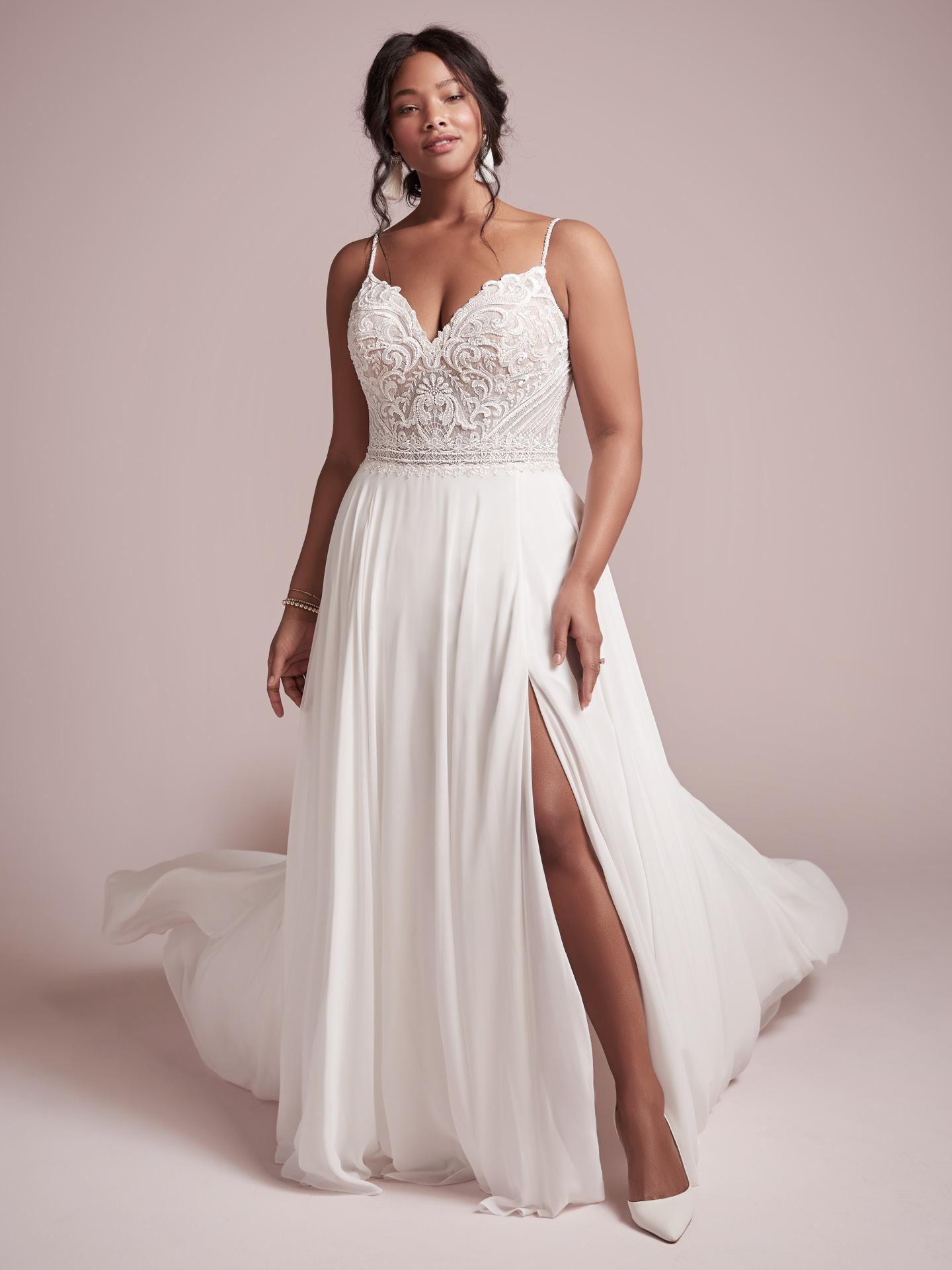 Curvy Model Wearing Plus Size Beach Chiffon Wedding Gown Called Lorrained by Rebecca Ingram