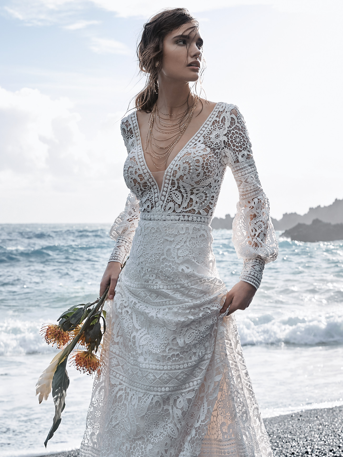 Model on Beach Wearing Lace Bishop Sleeve A-line Wedding Dress Called Finley by Sottero and Midgley
