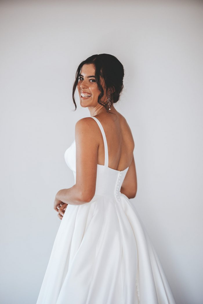 Bride Wearing a Glamorous Wedding Makeup Look and a Satin Ball Gown Wedding Dress Called Selena by Maggie Sottero