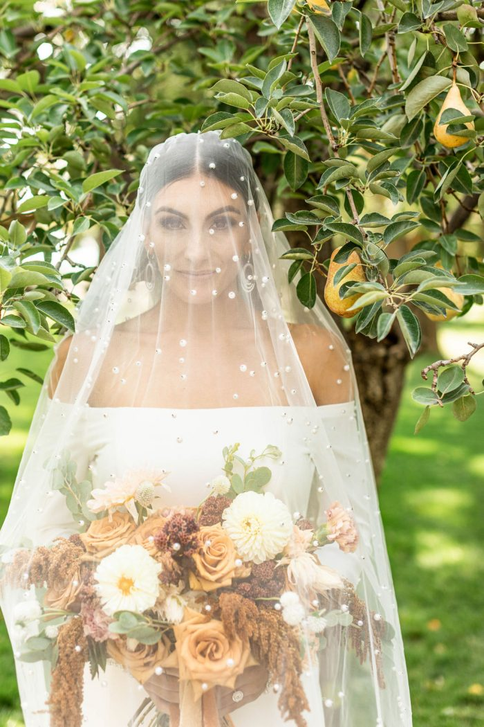 Bride Wearing Off-the-Shoulder Bridal Dress Called Admina by Sottero and Midgley