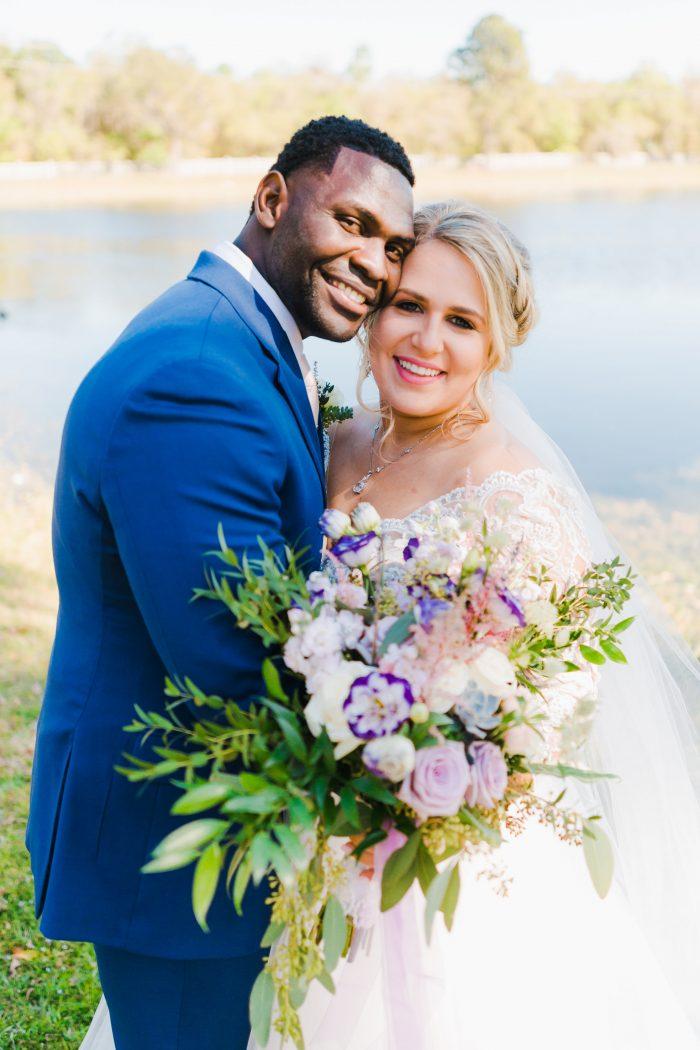 Groom Hugging Bride Wearing Spring Bridal Makeup and a Maggie Sottero Wedding Dress