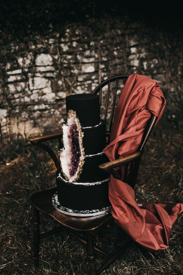 Black and Purple Geode Wedding Cake on Chair for Halloween