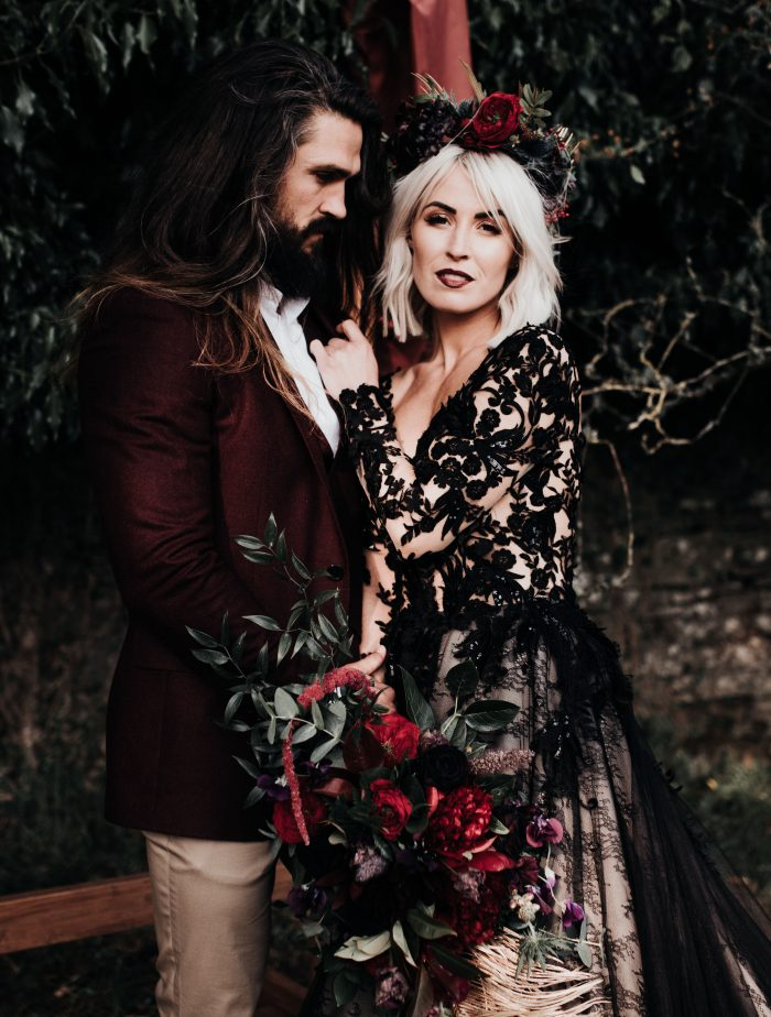 Groom with Bride Wearing Gothic Wedding Makeup Look and Zander Black Wedding Dress by Sottero and Midgley