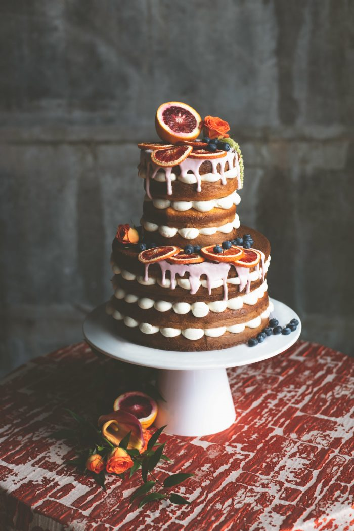 Fall Wedding Cake with Citrus Accents and Oranges on Top