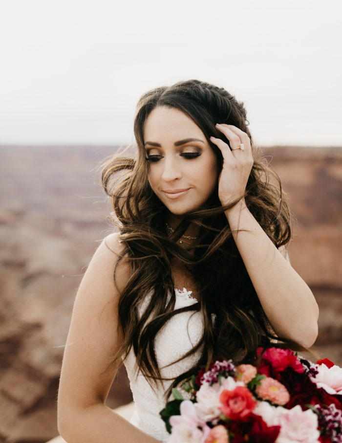 Bride at Dead Horse Point Bridal Wearing Romantic Wedding Makeup Look with Rebecca Ingram Wedding Gown