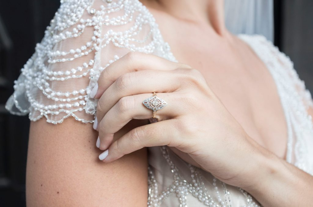 Bride Wearing Vintage Wedding Dress by Maggie Sottero and Showing Engagement Ring on Her Hand