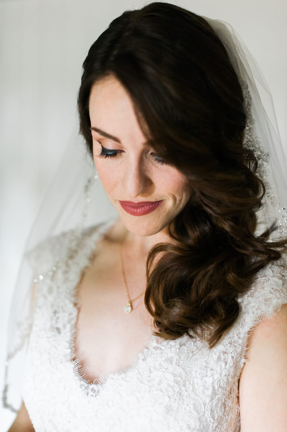 Cute Girls' Hairstyles - Deep side part with side-swept curls with Bronwyn by Maggie Sottero