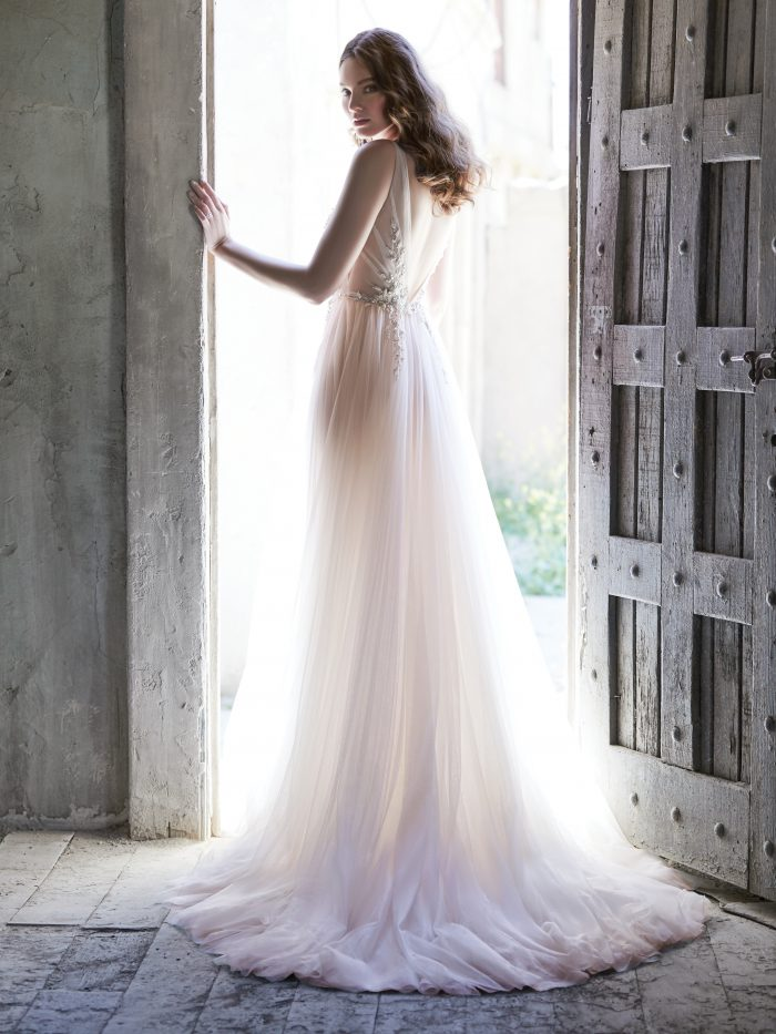 Model From Back Wearing V-back Wedding Dress Called Meletta by Maggie Sottero