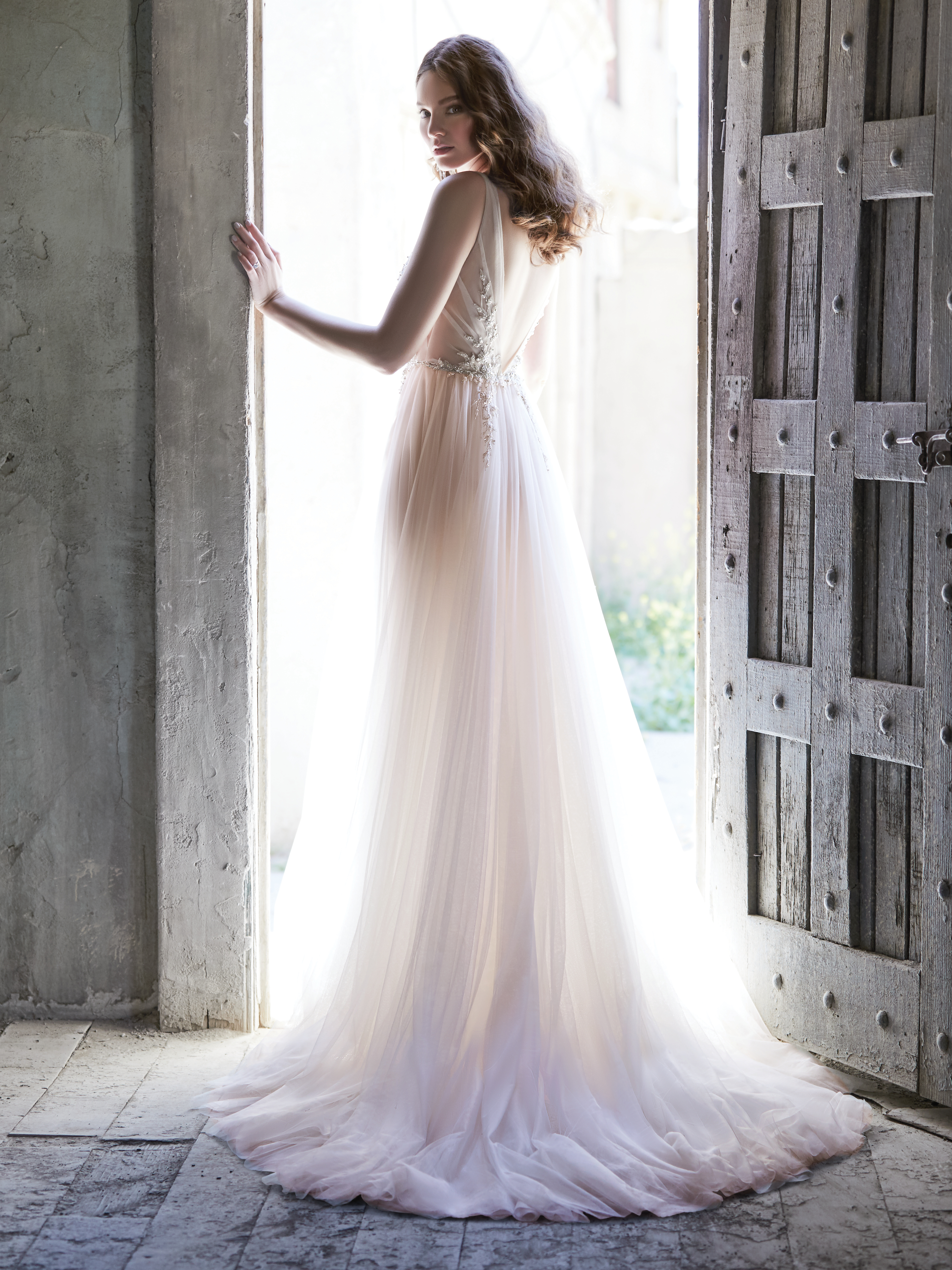 Model from back Wearing Tulle A-line Wedding Dress Called Meletta by Maggie Sottero