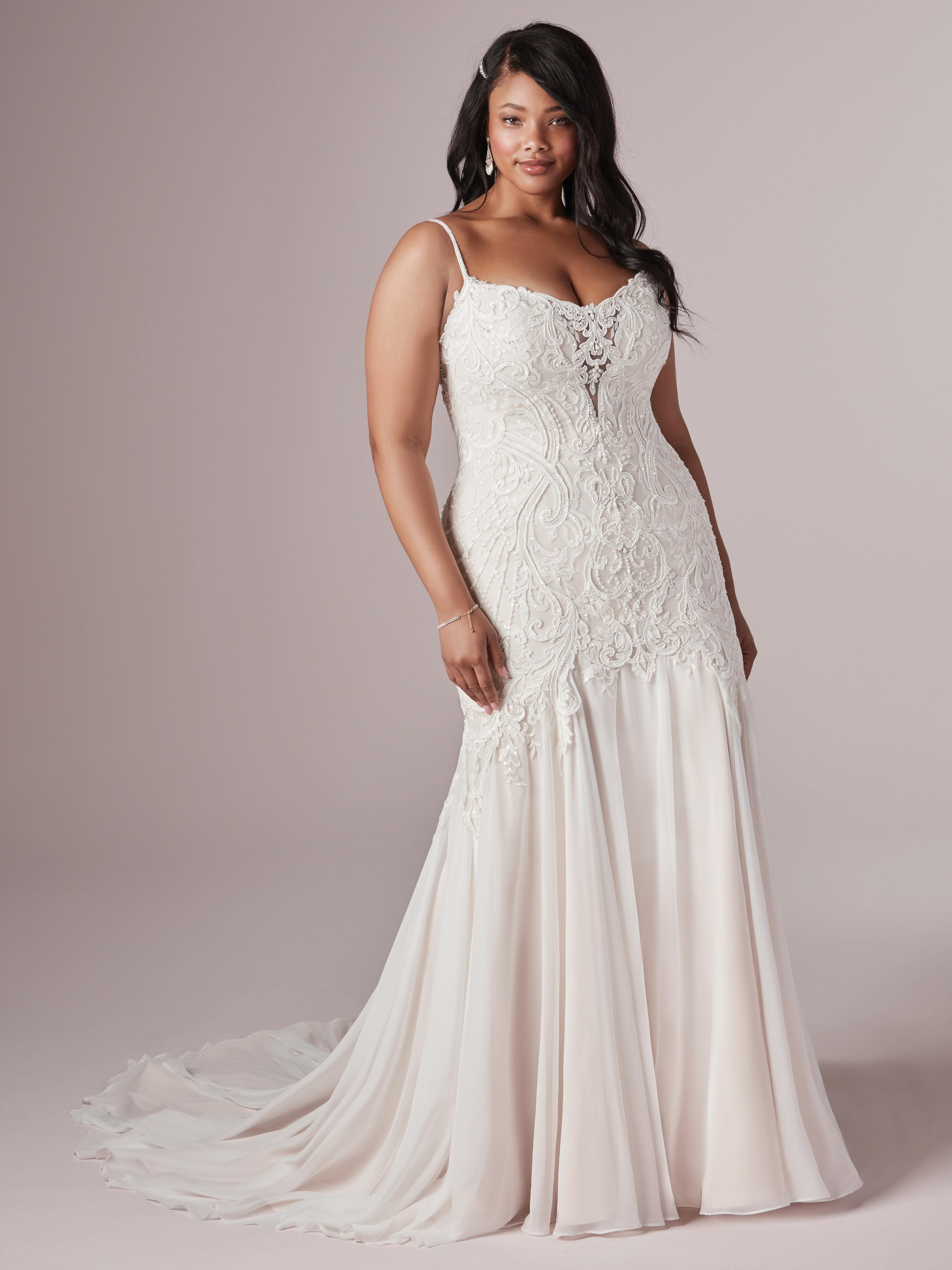 Plus Size Model Wearing Sheath Wedding Dress Called Corrine by Rebecca Ingram