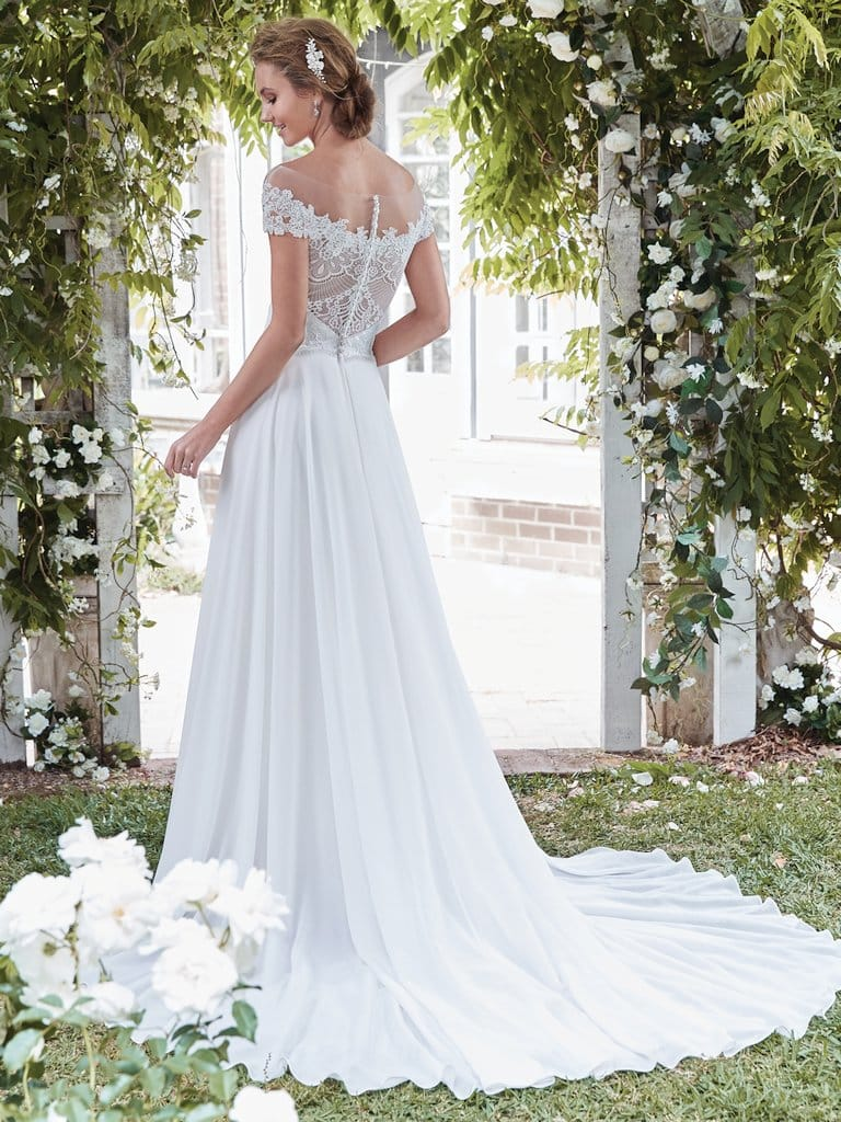 Lightweight Gatsby Gowns for a Summer Wedding - This sweet and simple lace-and-chiffon gown lends itself to a variety of wedding aesthetics, including your summer-garden soiree. Beatrice wedding dress by Rebecca Ingram