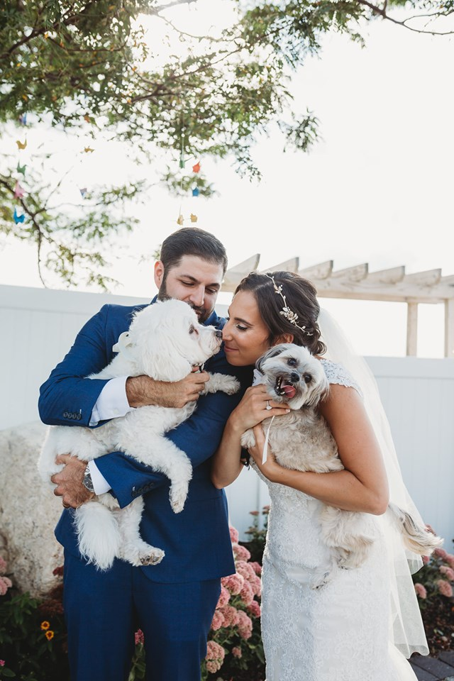 Real Bride and Groom Holding Their Two Dogs During Wedding Poses for Photo Session