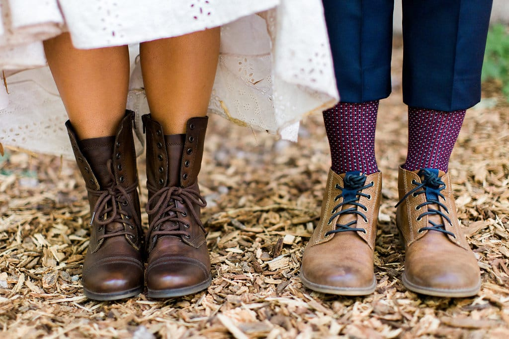 Our Favorite Boho Brides and Boho Wedding Dresses! - Midgley Bride wearing Nicole by Sottero and Midgley. She wore boots to her boho chic outdoor wedding.