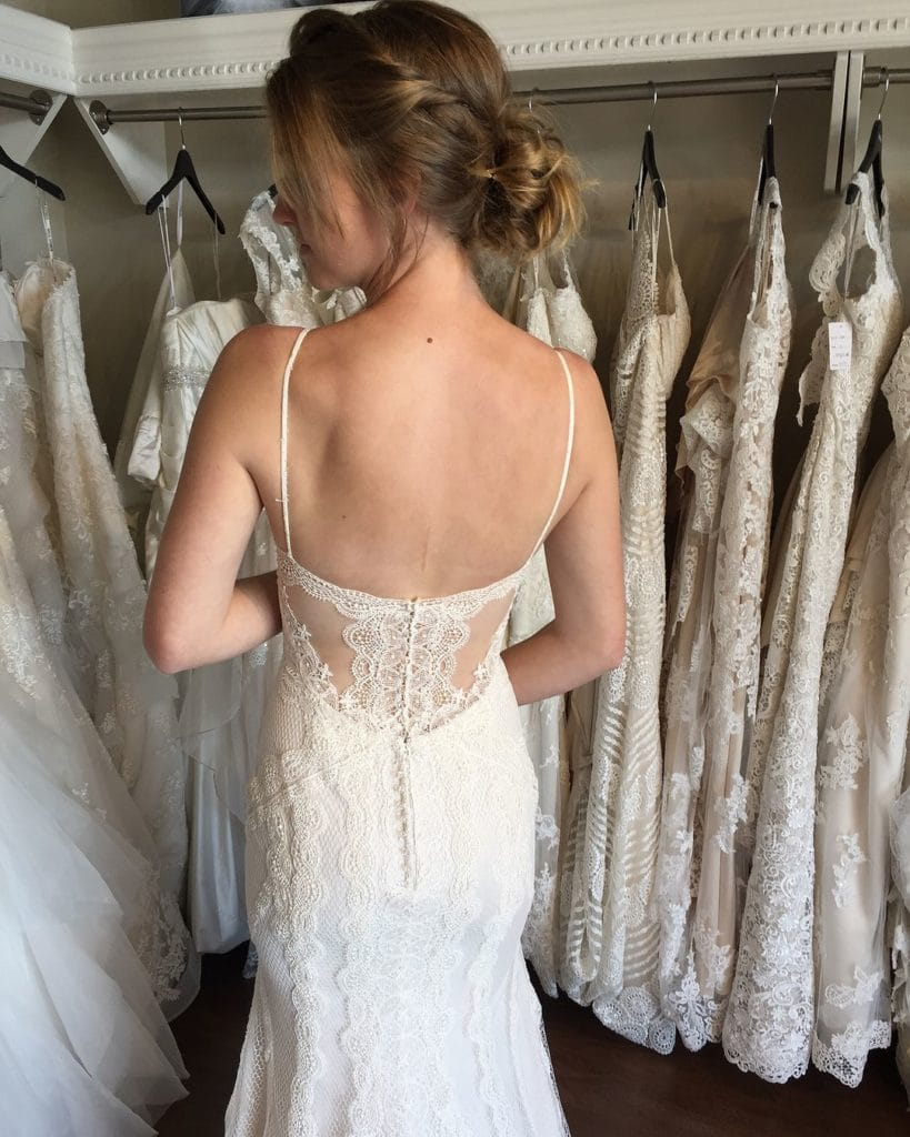 Bride Trying on Backless Wedding Gown