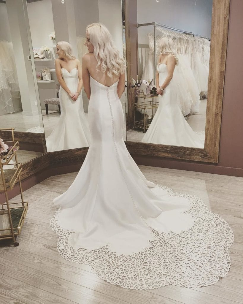 Bride in Mirror Trying on Wedding Gown