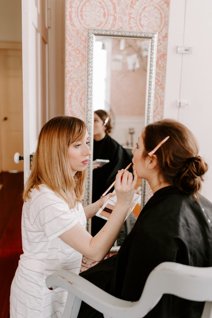 Bride Getting Her Bridal Makeup Done Before Her Wedding