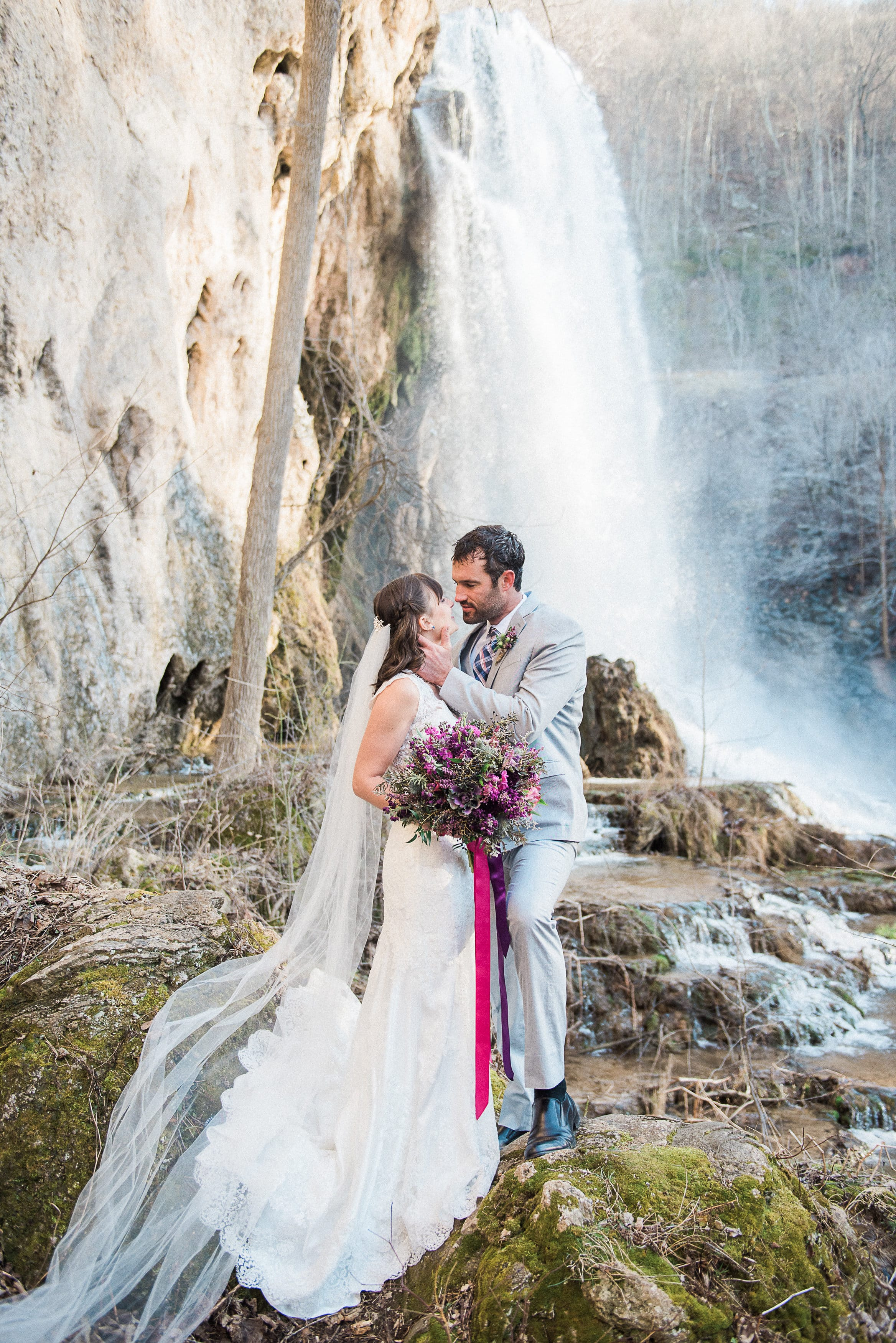 Lace Gown Melanie with Jewel Tones and Waterfall - Maggie Sottero's Melanie gown styled with a jewel-tone wedding palette and a waterfall wedding venue.