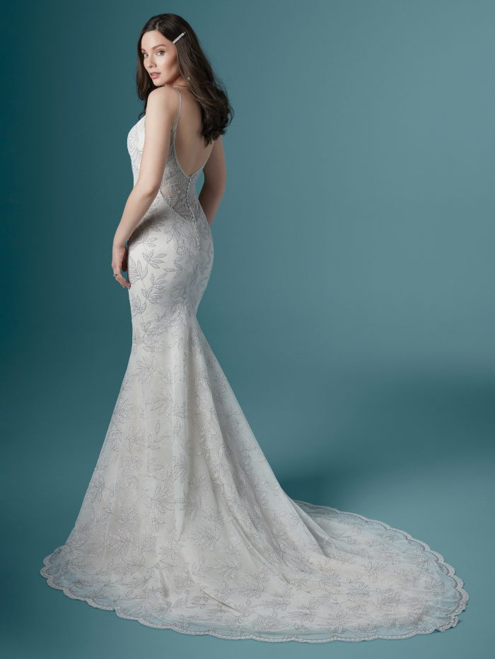 Model Wearing Sparkly Wedding Gown with Silver Accents Called Demi by Maggie Sottero