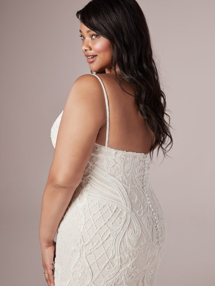 Model Wearing Plus Size Blush Wedding Gown Called Corrine by Rebecca Ingram