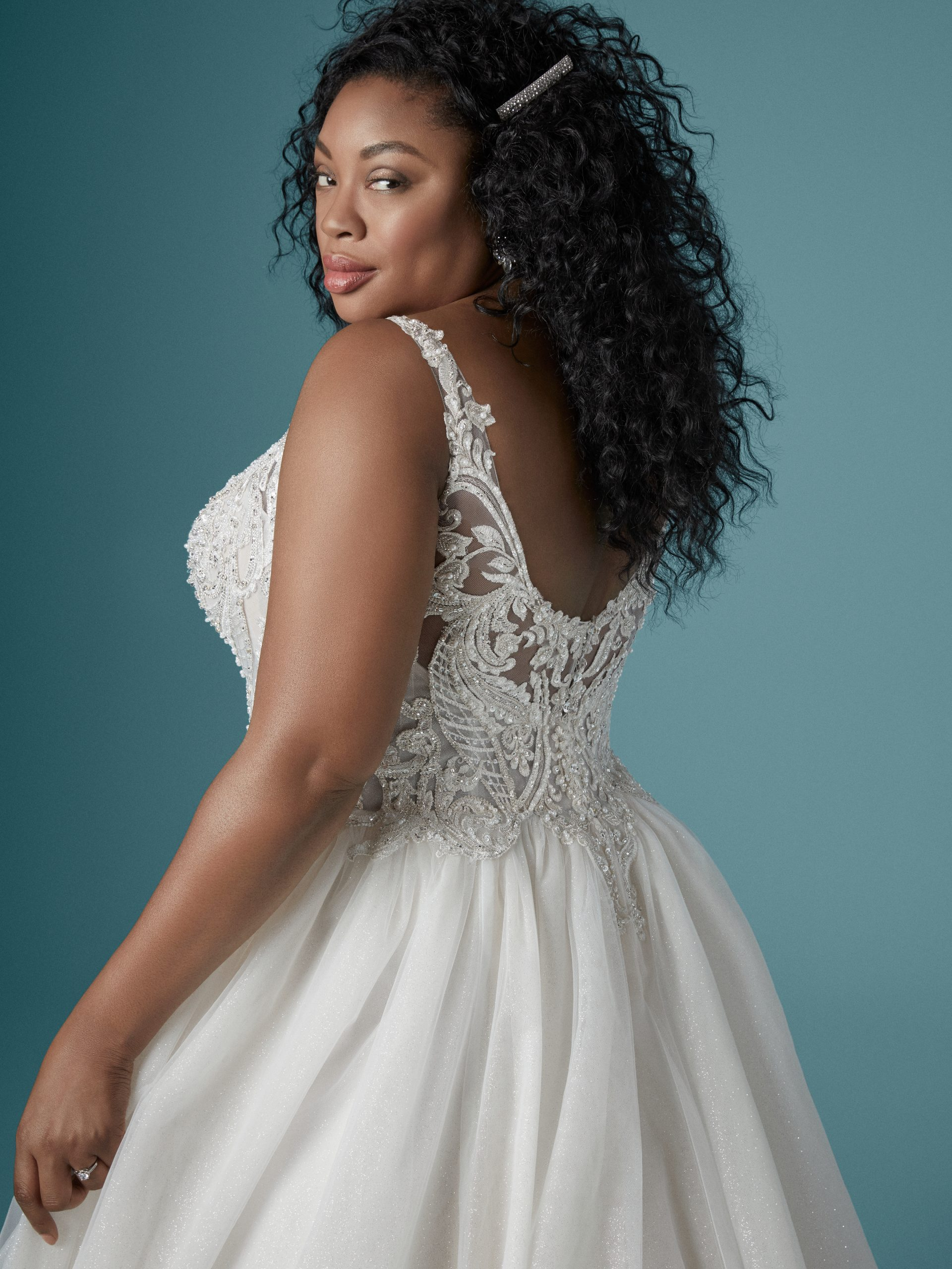 Model Wearing Plus Size V-neck Ball Gown Wedding Dress Called Taylor Lynette by Maggie Sottero
