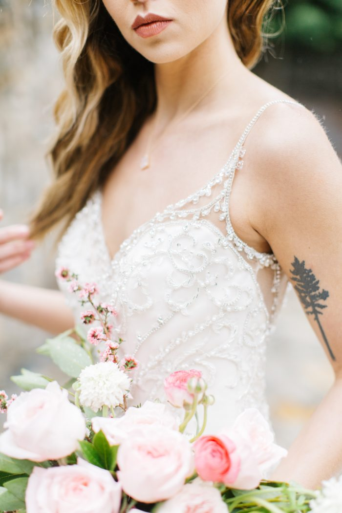 Pink bouquet and Bride wearing a Beading Maggie Sottero Wedding Dress