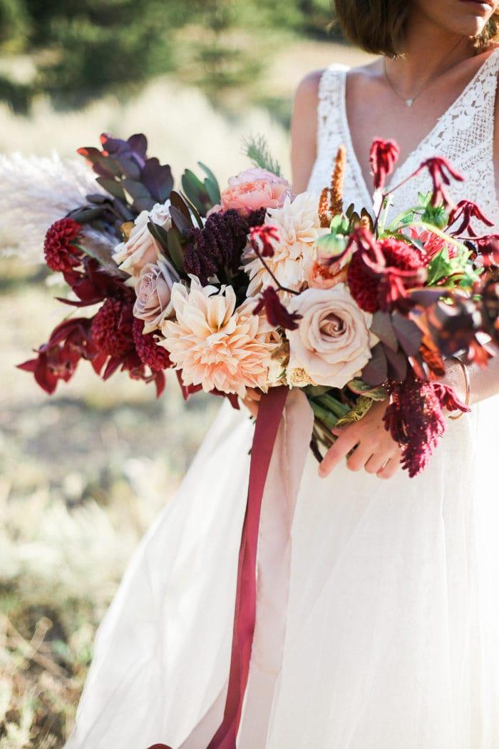 Bride holding colorful bridal bouquet
