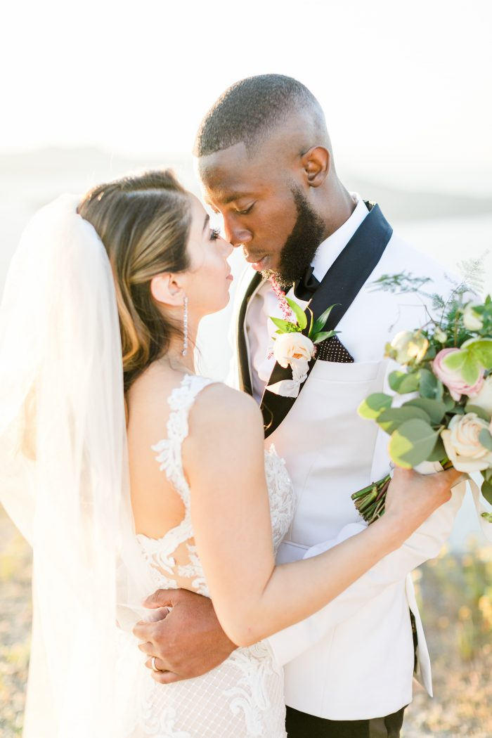Groom with Real Bride Wearing Side Swept Hair and Abbie Wedding Gown by Maggie Sottero