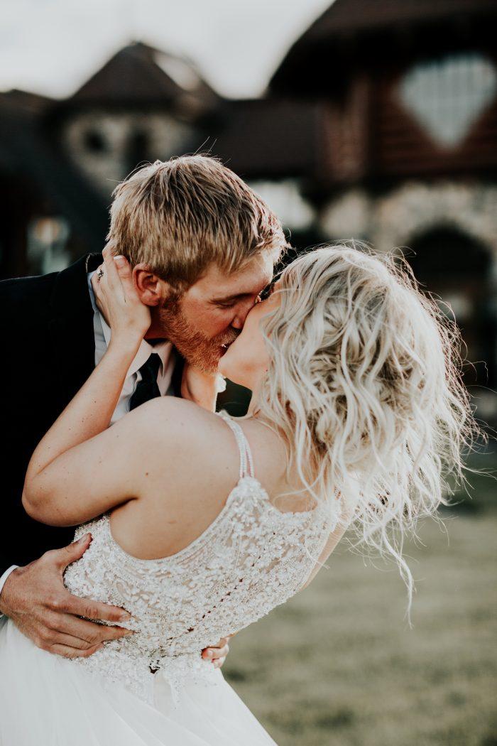Groom with Real Bride Wearing Wedding Updo with Halter Top Wedding Dress