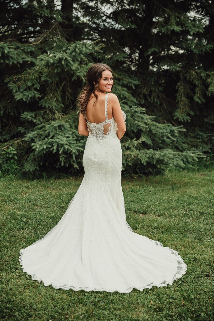 Bride Wearing FishTail Braid and Narissa Wedding Gown by Sottero and Midgley