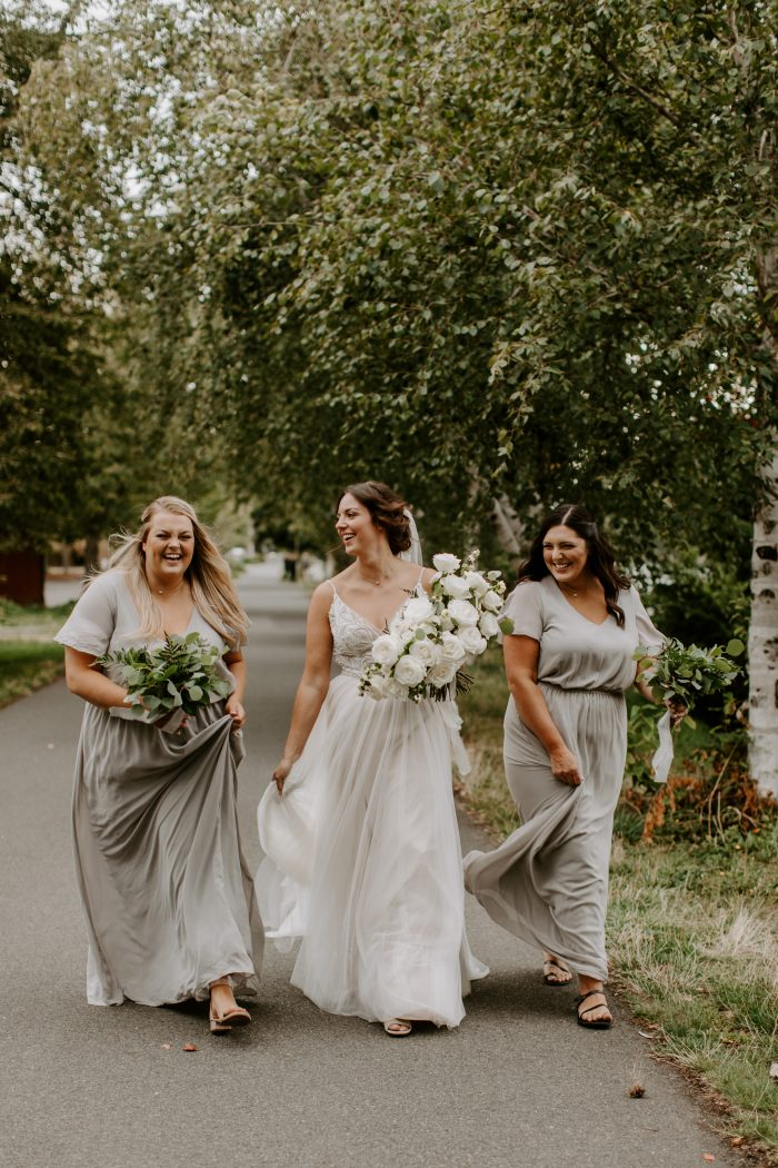 Bride Wearing Charlene Wedding Dress by Maggie Sottero and Walking with Two Bridesmaids
