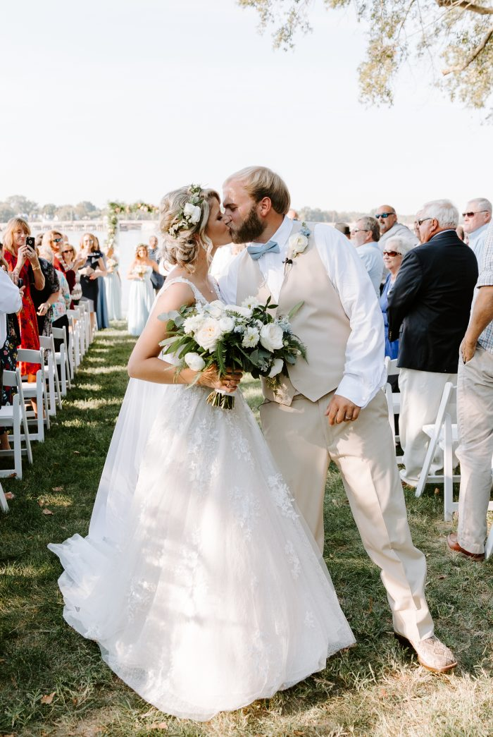 Groom with Real Bride Wearing Updo with Flower Crown and a V-neck Wedding Gown Called Meryl by Maggie Sottero