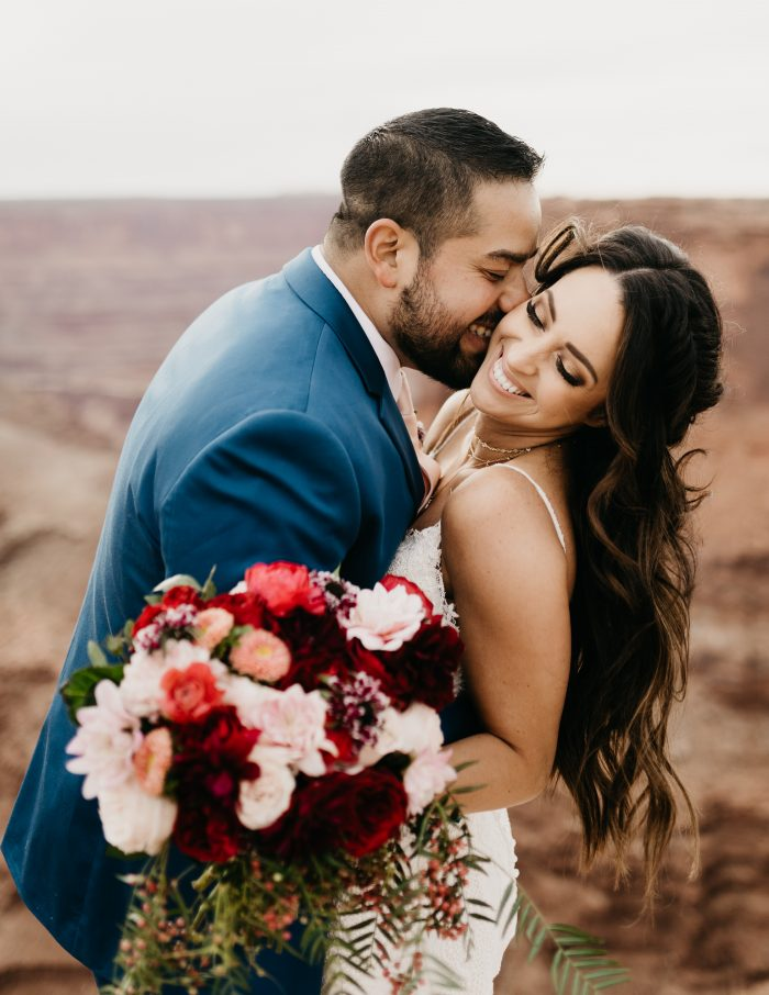 Groom with Real Bride Wearing Half Upo and Wedding Dress Called Narissa by Sottero and Midgley