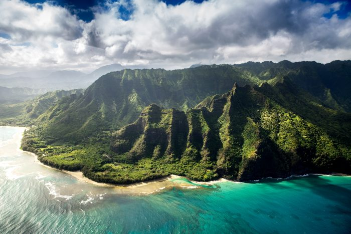Aerial View of Gorgeous Beach and Vibrant Green Cliffs on Kauai, Hawaii