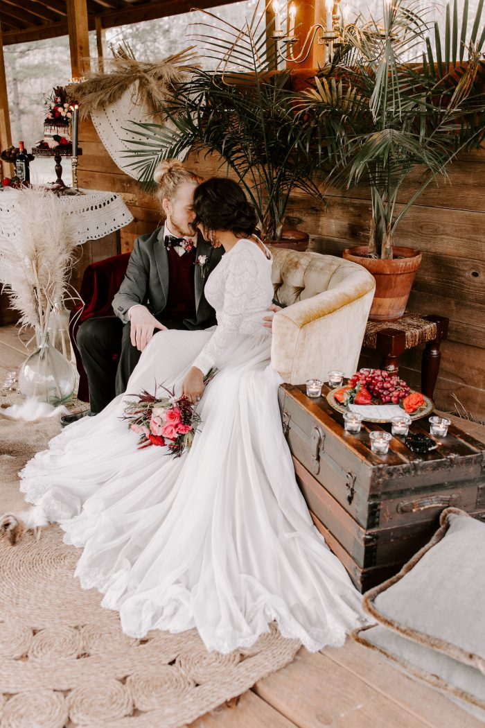 Bride and Groom Sitting on Vintage Couch at Outdoor Wedding Venue