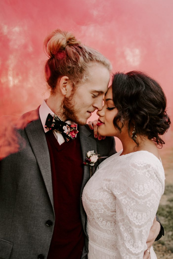 Close Up of Groom With Black Bride Wearing Modest Wedding Dress Called Deirdre Marie by Maggie Sottero