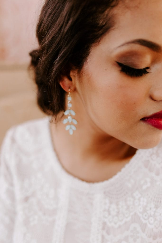 Bride Wearing Makeup and Showing off Wedding Skincare Regimen with Glowing Skin