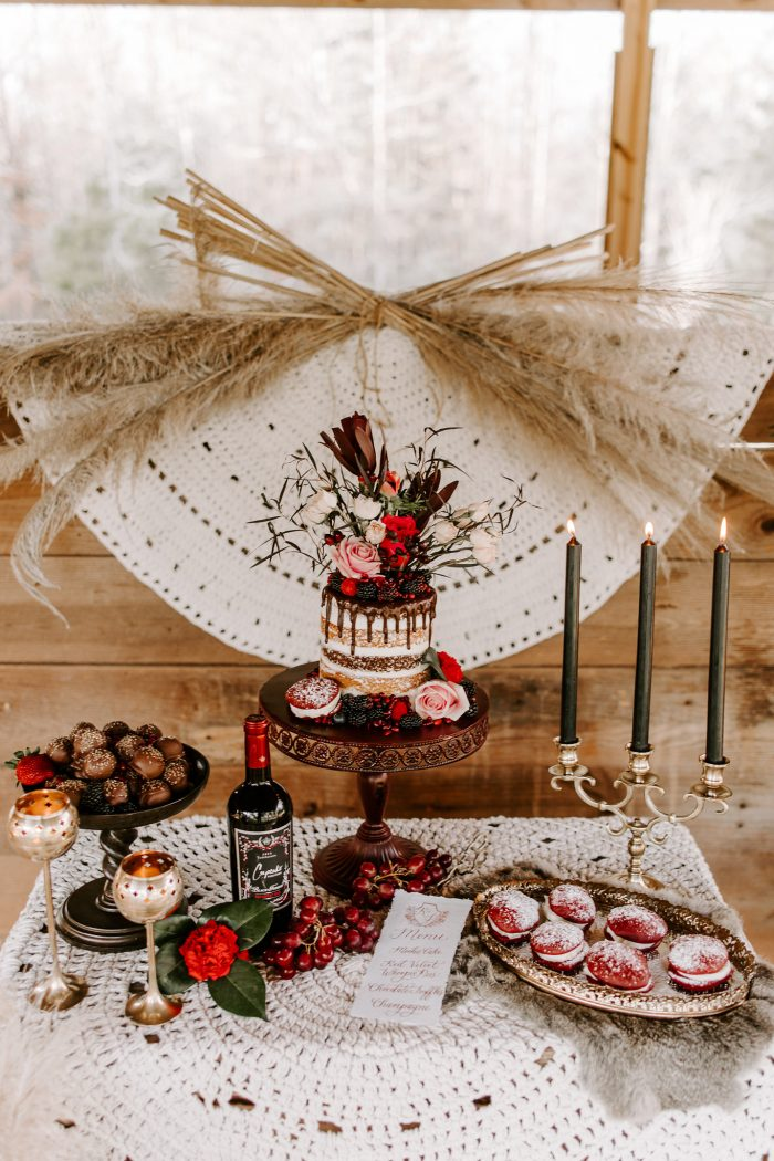 Valentine's Wedding Cake on Dessert Table with Vintage Candles and Red Velvet Cookies