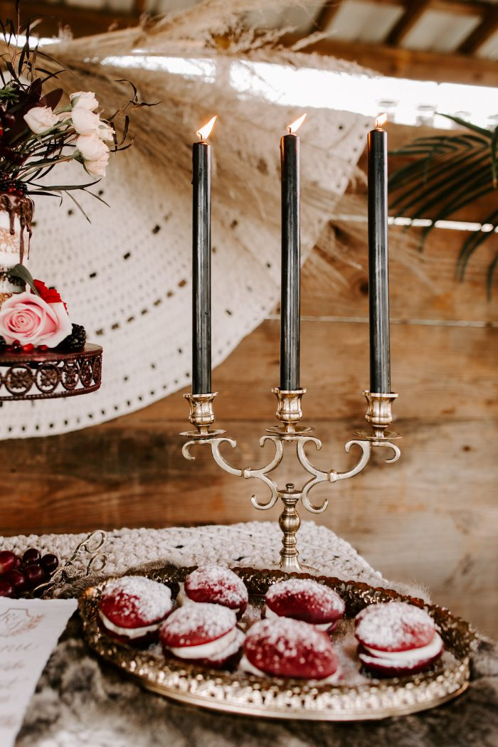 Vintage Candles on Table with Red Velvet Cookies with Cream Filled Middle for Fall Wedding Reception