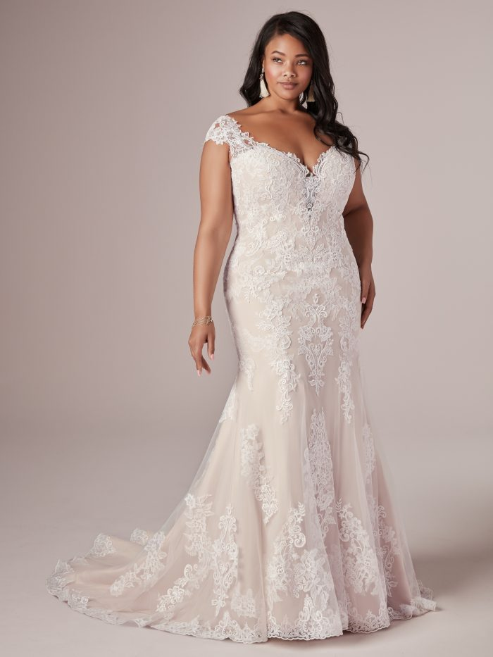 Model Wearing Plus Size Wedding Dress Called Daphne Lynette by Rebecca Ingram