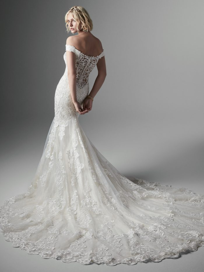 Model Wearing Sweetheart Neckline Fit-and-Flare Wedding Dress Called Kennedy by Sottero and Midgley