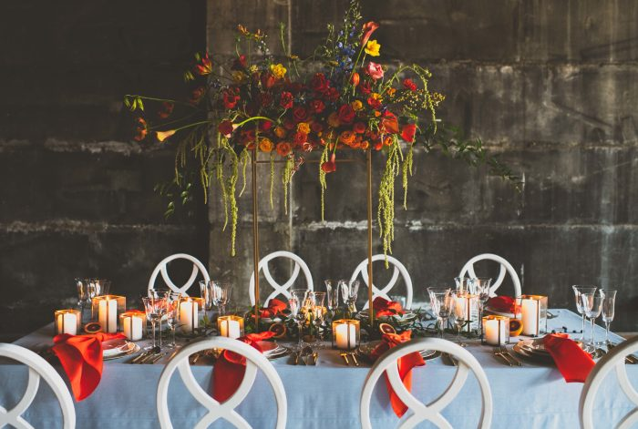 Florals and Table Settings Featuring Crimson Orange and Greenery Fall Wedding Color Palette