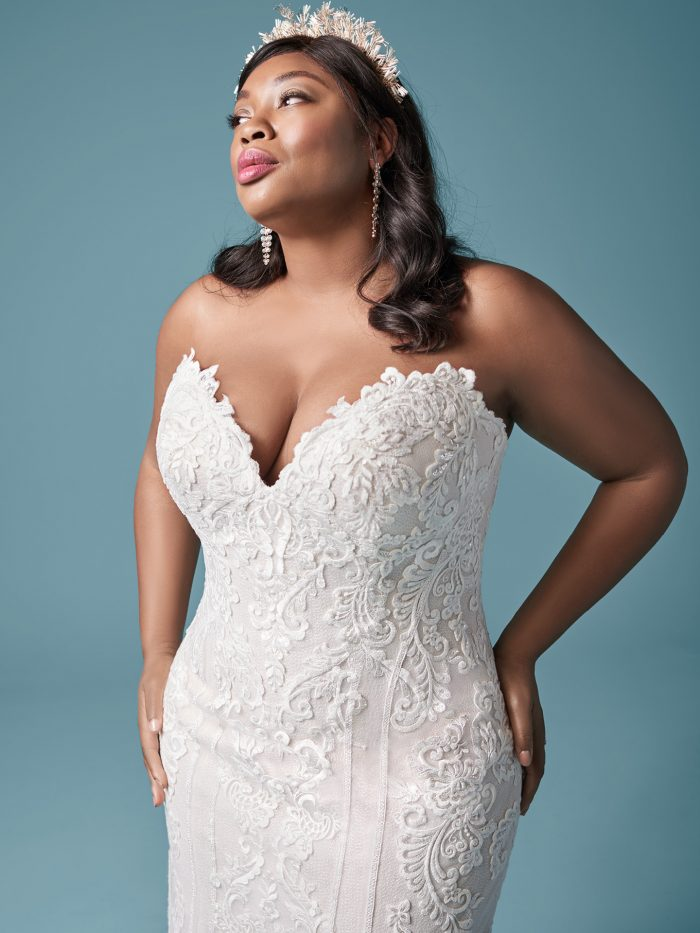 Curvy Model Wearing Strapless Plus Size Wedding Dress Called Erin Lynette Marie by Maggie Sottero