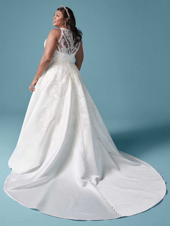 Plus Size Model Wearing Plus Size Embroidered Satin Ball Gown Wedding Dress Called Tamika by Maggie Sottero