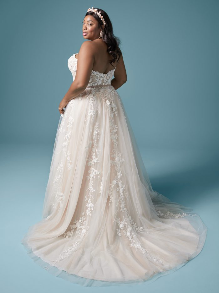 Curvy Model Wearing Plus Size Floral A-line Bridal Dress Called Zareen Lynette by Maggie Sottero