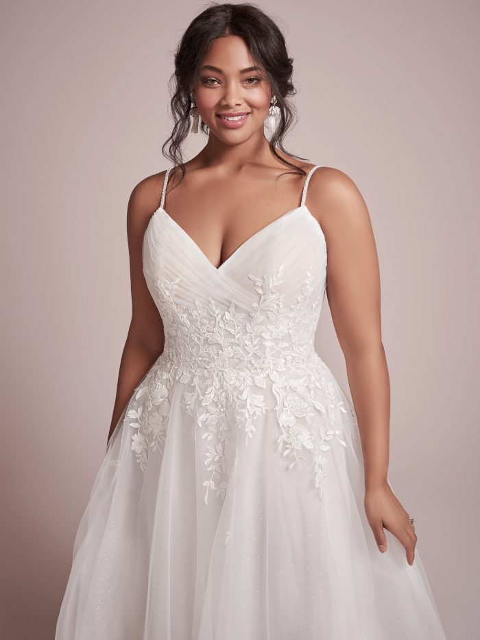 Plus Size Model Wearing Plus Size Princess Wedding Gown Called Mila by Rebecca Ingram