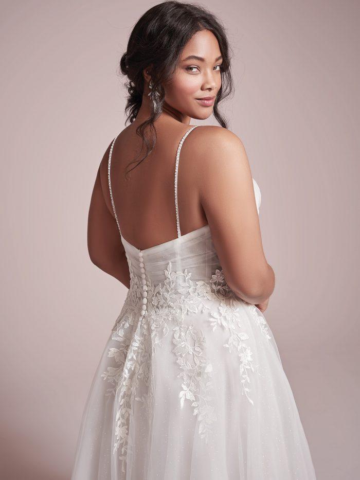 Plus Size Model Wearing Lightweight A-line Wedding Dress Called Mila by Rebecca Ingram