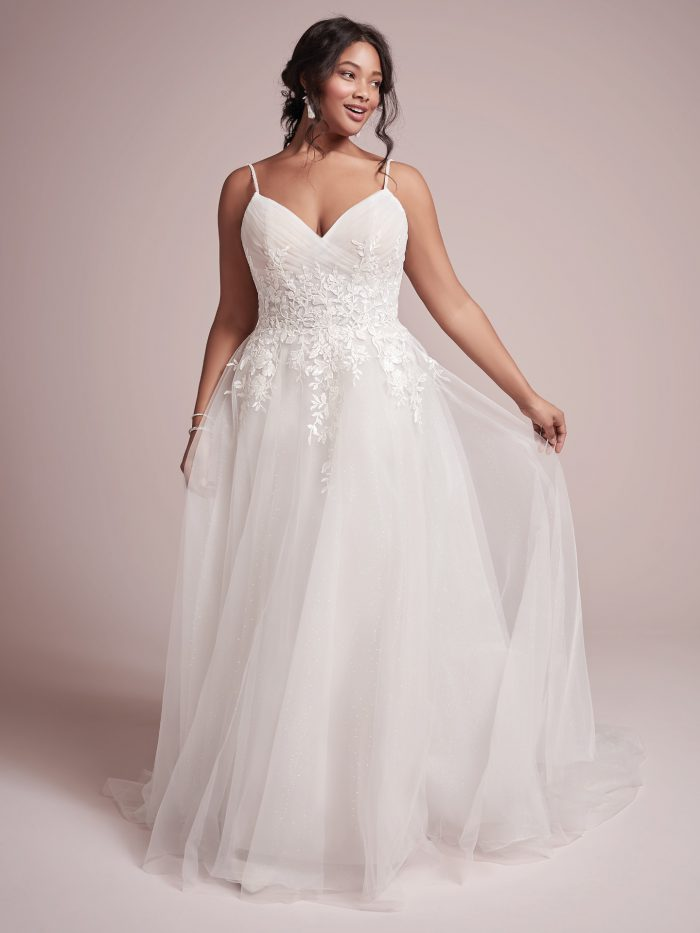 Curvy Model Wearing Plus Size Princess Wedding Gown Called Mila by Rebecca Ingram
