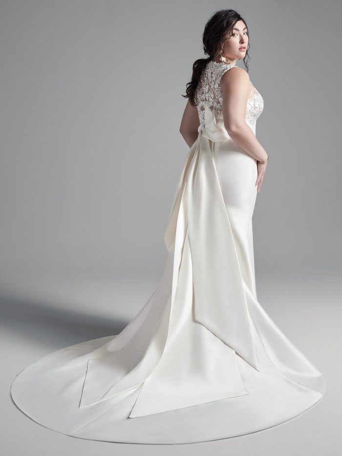 Plus Size Model Wearing Plus Size Mikado Sheath Wedding Dress Called Boden by Sottero and Midgley