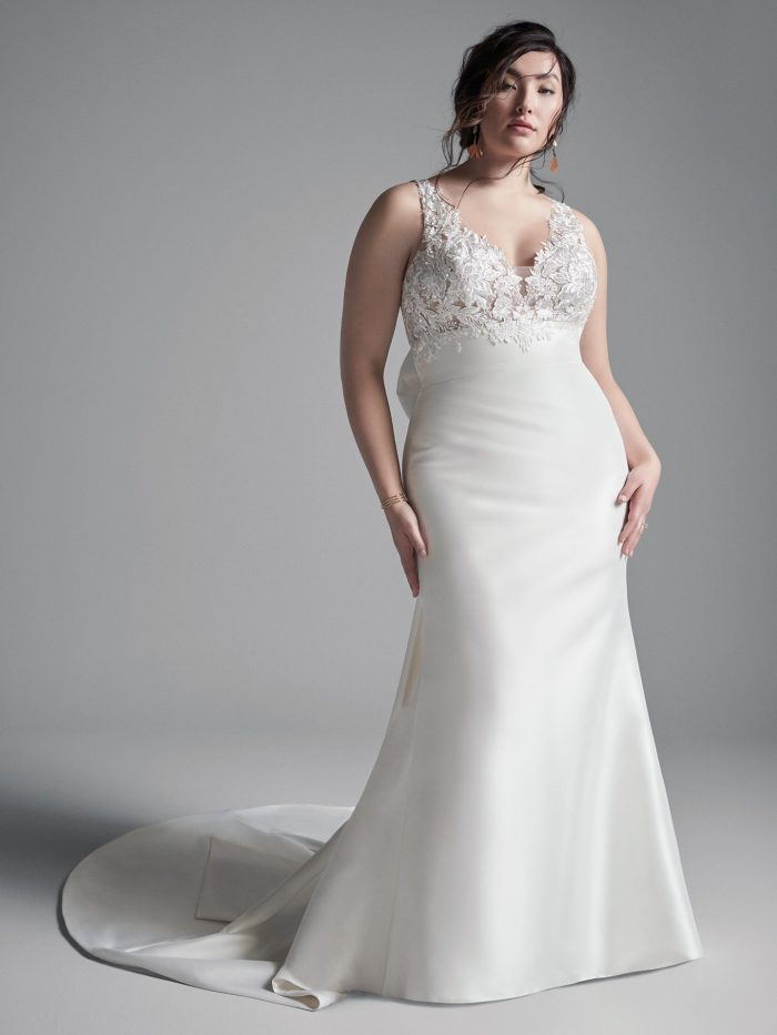 Curvy Model Wearing Plus Size Satin Sheath Wedding Dress Called Boden by Sottero and Midgley