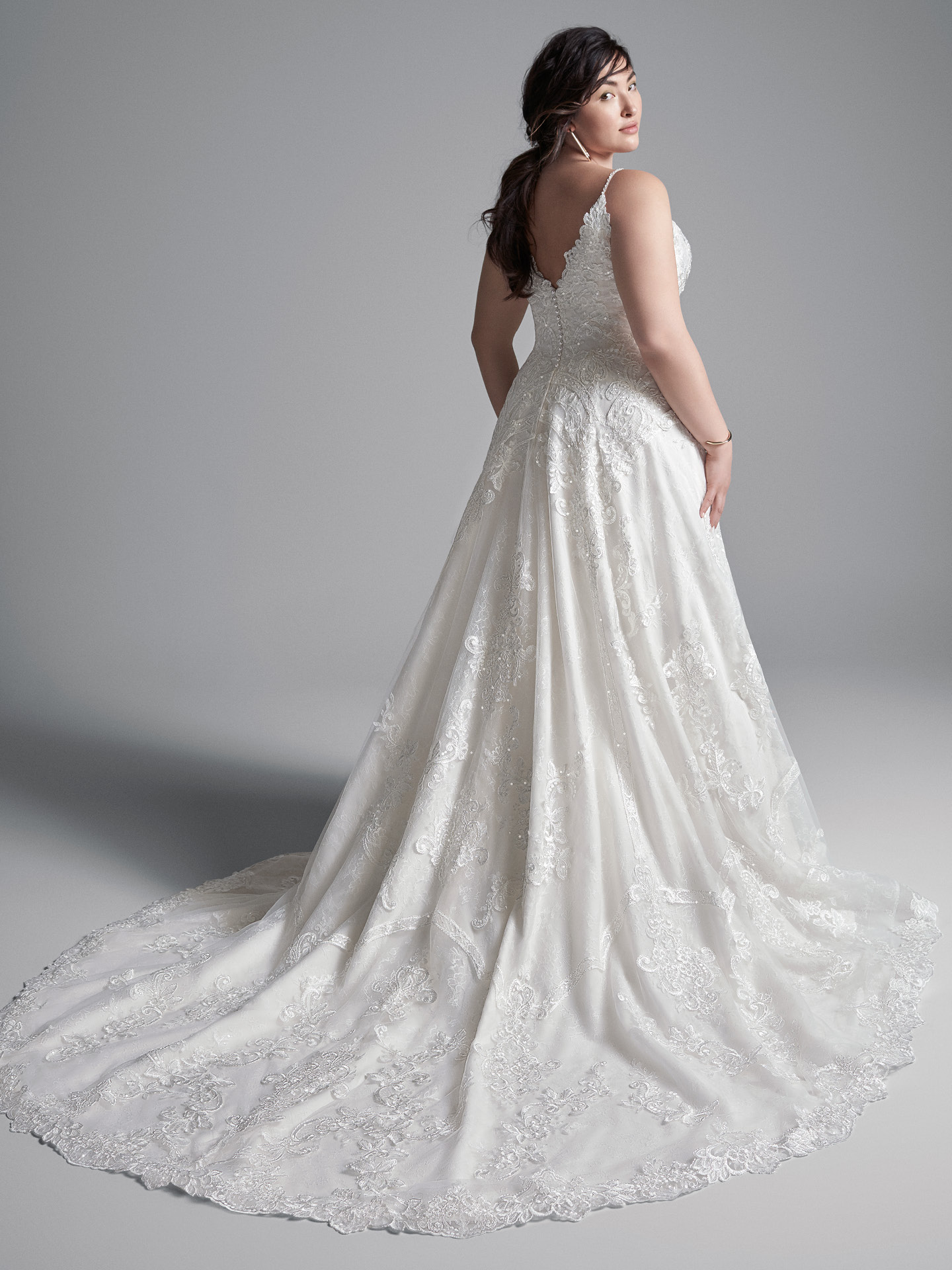 Plus Size Model Wearing Plus Size Lace A-line Wedding Gown Called Lancaster by Sottero and Midgley